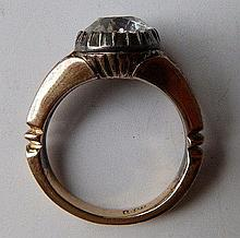 A diamond solitaire ring, the collet set old cut stone weighing approximate