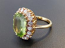 A peridot & diamond cluster ring of canted rectangular form on yellow metal