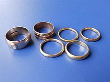 A 22ct gold wedding band, and 18ct band and four o