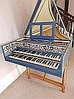 A double manual harpsichord in blue painted wood c