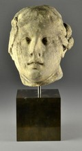 A Greek or Italian Carved Stone Head of a Woman
