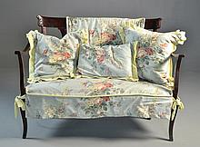 An Antique Carved Victorian Settee