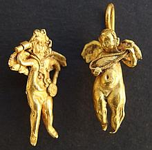 TWO GREEK GOLD EROS EARRINGS Greco-Roman Period