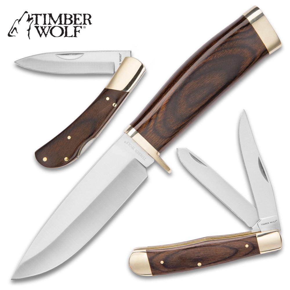 Lot 207: New Timber Wolf The Legend Of The Pack Three-Piece Knife Set - Stainless Steel Blades, Wooden Handles, Brass Accents