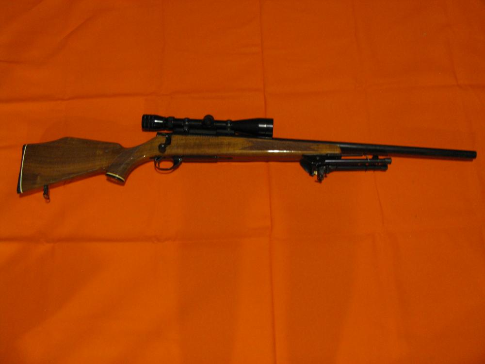 Lot 15: Smith & Wesson Model 1500 Varmint Model Caliber 22-250 Excellent with a Harris Bipod.