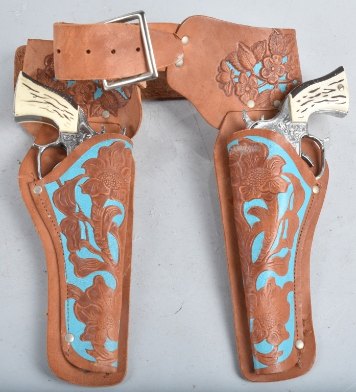 2- COWPOKE CAP GUNS & LEATHER HOLSTER