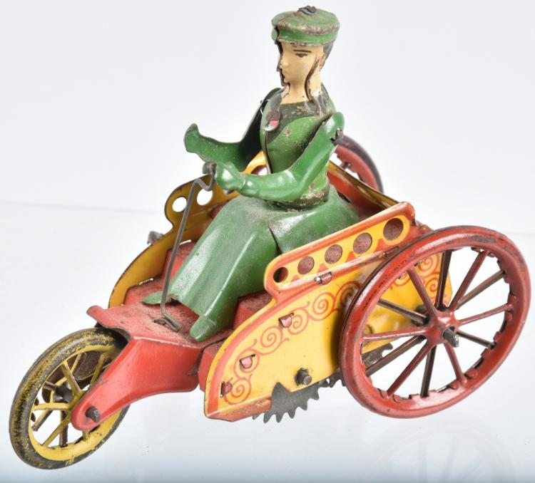 STOCK Tin Windup LADY IN HORSELESS CARRIAGE