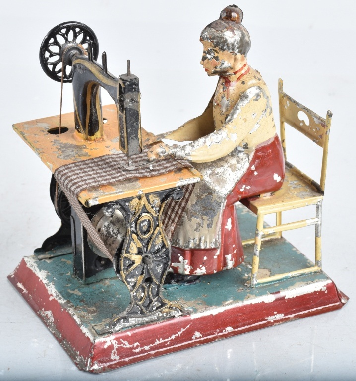 GUNTHERMAN Painted Tin LADY AT SEWING MACHINE