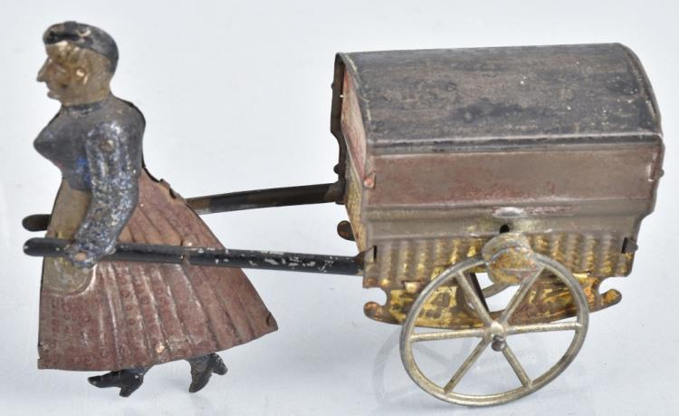 FRENCH Tin Flywheel LADY PULLING CART