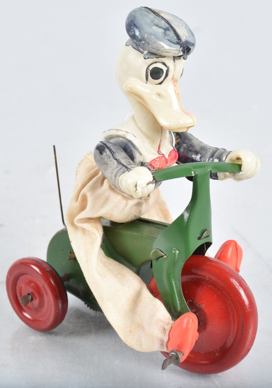 JAPAN Celluloid Windup LONG BILL DONALD ON TRIKE