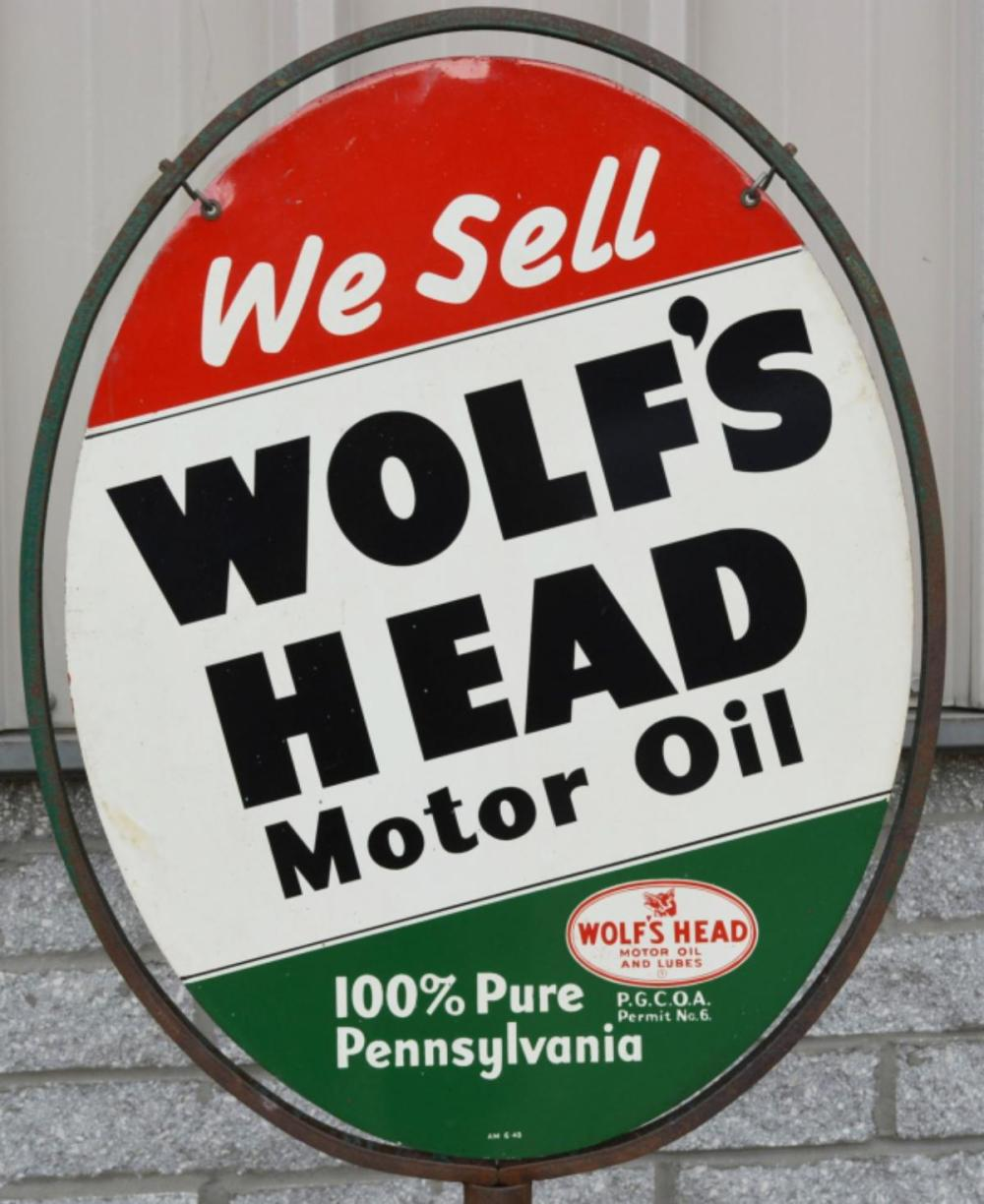 We Sell Wolf's Head Motor Oil Metal Sign