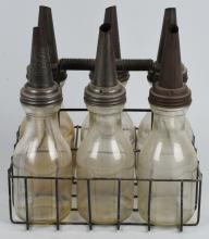 6 GLASS OIL BOTTLES WITH CARRIER