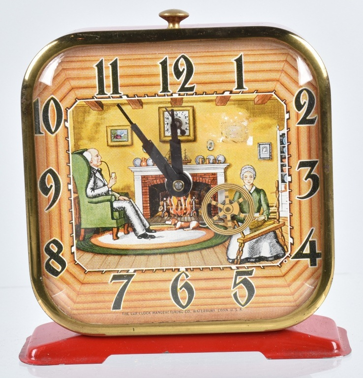 LUX ANIMATED SPINNING WHEEL NOVELTY CLOCK