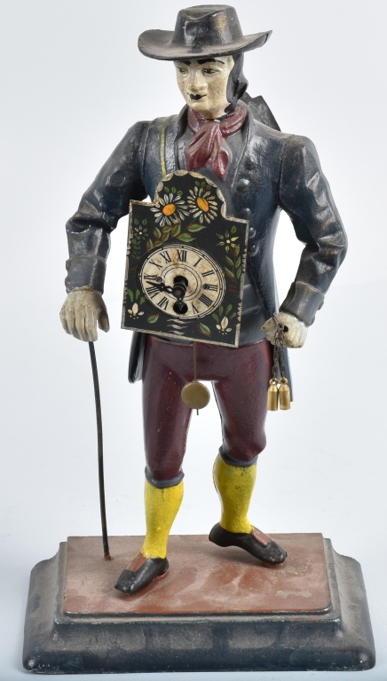 FIGURAL CAST METAL CLOCK VENDOR
