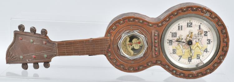 CAST METAL GUITAR, with ANIMATED CLOCK