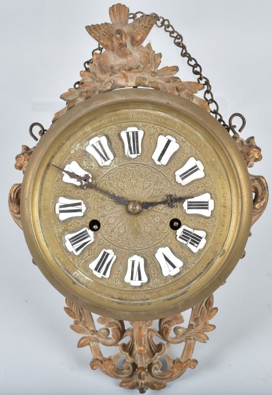 EARLY BRASS AND CAST IRON WALL CLOCK