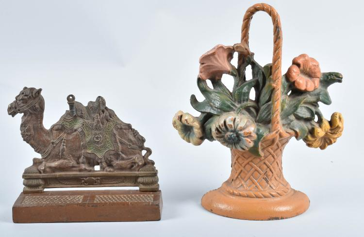 2-CAST IRON DOORSTOPS, CAMEL & BASKET OF FLOWERS