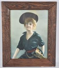ART SPECIALTY CO., WOMAN with REVOLVER, FRAMED