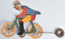 UNCLE SAM ON BICYCLE STRING BALANCE TOY