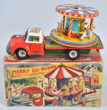 JAPAN Tin Friction MERRY GO ROUND TRUCK w/BOX