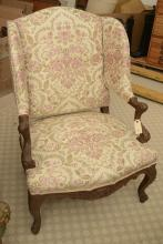 Nicely carved fruitwood wing back chair