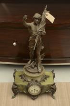 Spelter figural mantel clock after Perron