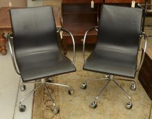 Pair Knoll type chrome, leather task chairs