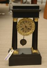 Vincent & Cie French ebonized portico clock