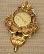 Louis XVI style giltwood cartel clock