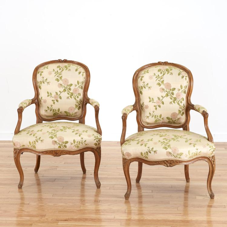 Pair Louis XV style fruitwood fauteuils
