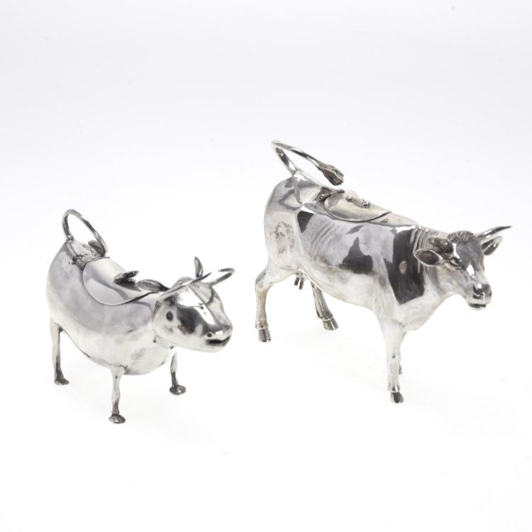 Two Dutch sterling cow creamers