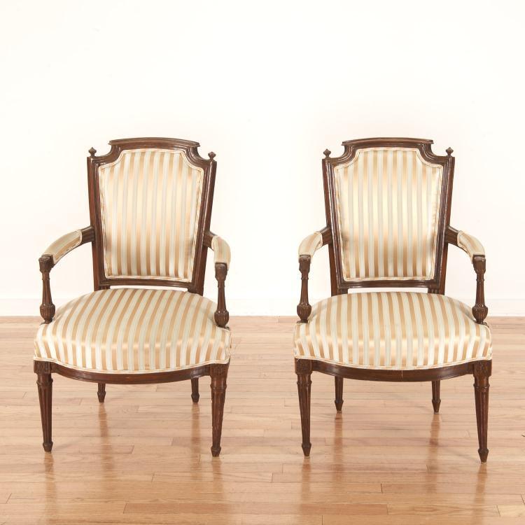 Pr Directoire silk upholstered mahogany fauteuils