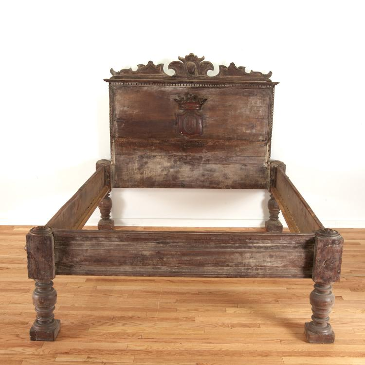 Italian Baroque carved walnut bed with crest