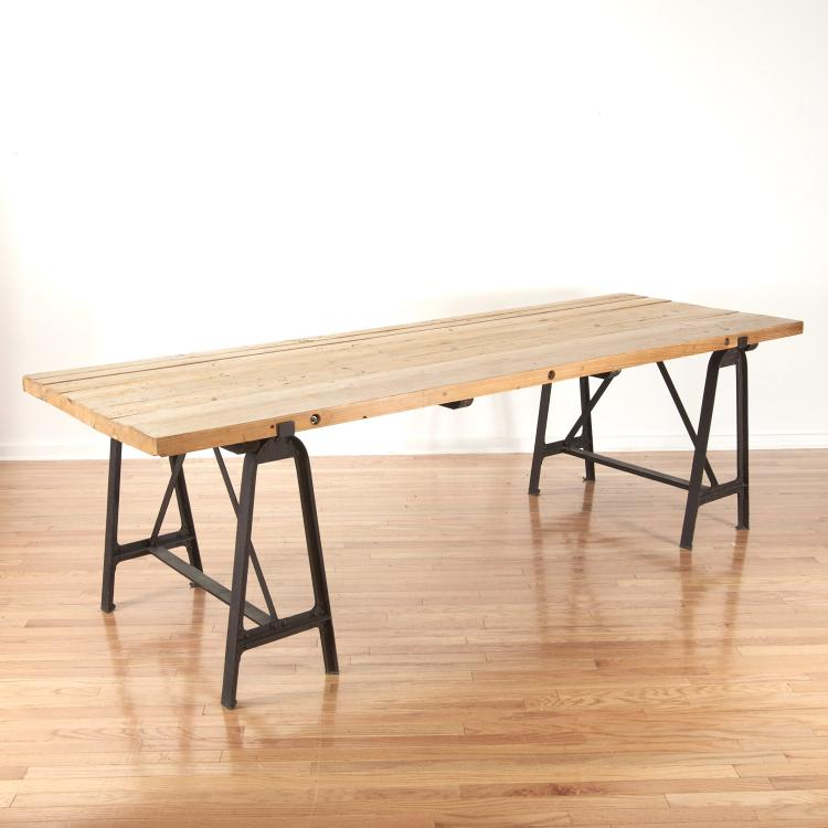 Industrial cast iron, reclaimed wood dining table
