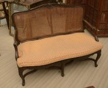 Louis XV style caned settee
