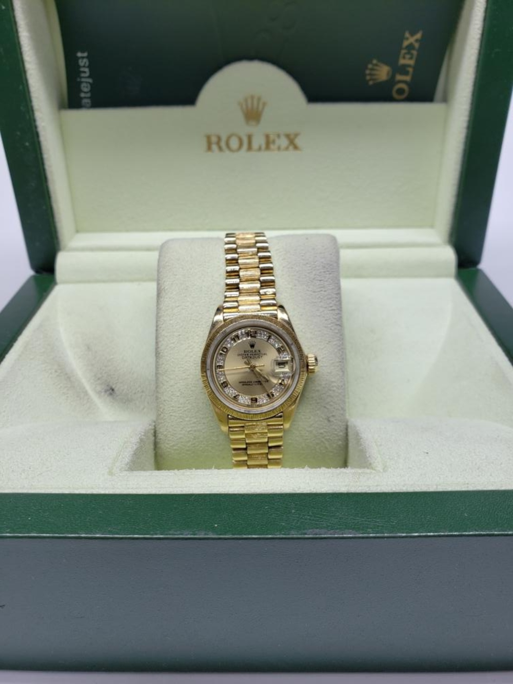 Lot 151: Rolex President Oyster Perpetual DateJust 18k Yellow Gold Myriad Diamond Dial Watch