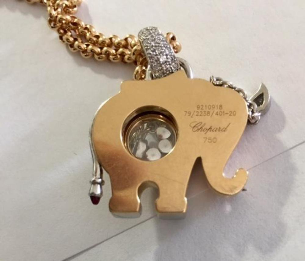 Lot 149: CHOPARD 18K Gold Elephant Pink Happy Diamond Pendant