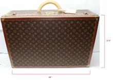 Lot 145: LOUIS VUITTON Monogram Canvas Bisten 65 Hardsided Suitcase Brown Leather