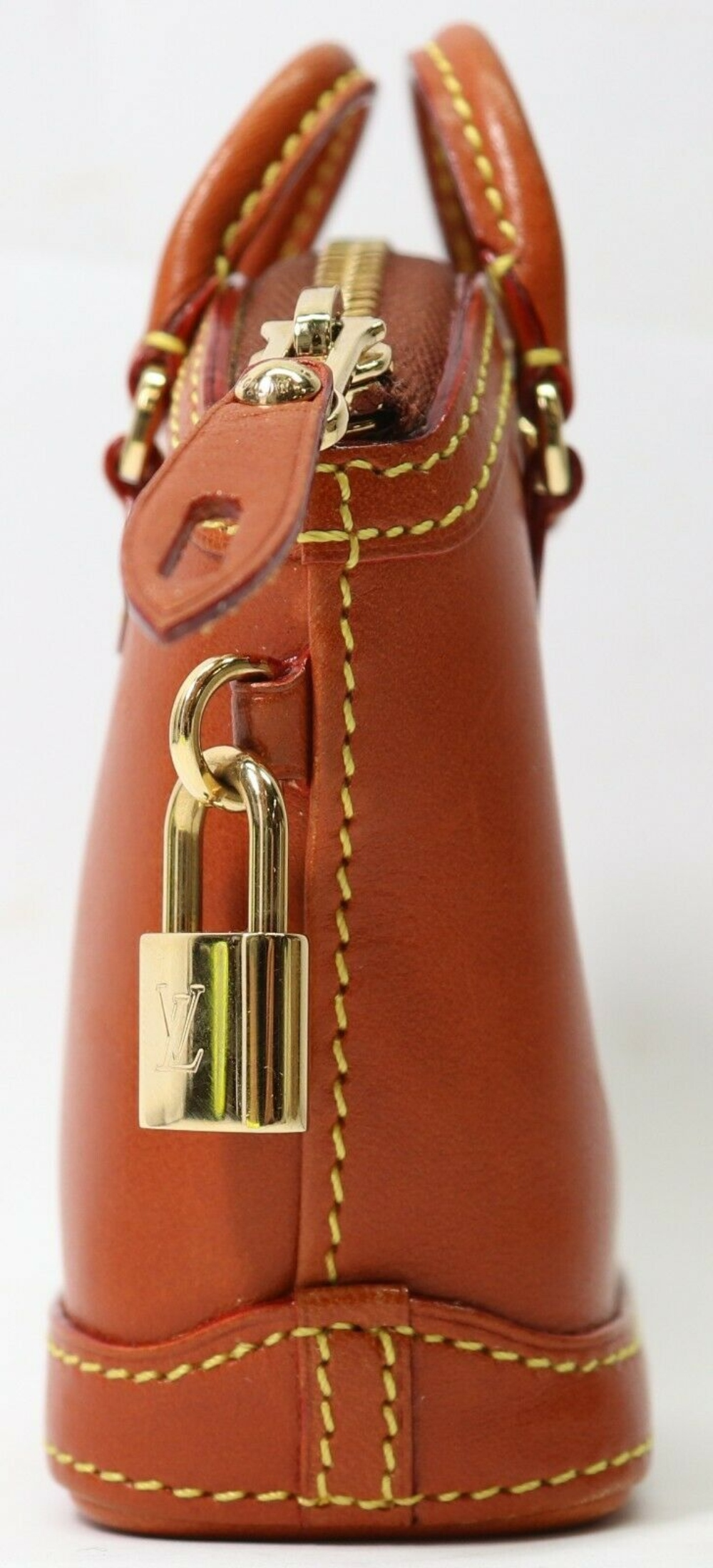 Lot 142: Louis Vuitton Mini Lockit Nomade Bag Leather brown Keychain Accessory Key Holder