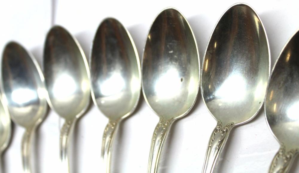 Lot 140: Prince Eugene Alvin 13pc Sterling Silver Spoons from 1940s. Total weight: 452 grams.