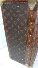 Lot 144: LOUIS VUITTON Monogram Canvas Bisten 70 Hardsided Suitcase Brown Leather