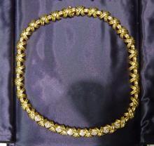 "Lot 60: TIFFANY & CO SIGNATURE DIAMOND ""X"" 18K GOLD NECKLACE"