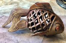 Lot 120: CHINESE CAST IRON KOI FISH CANDLE HOLDER