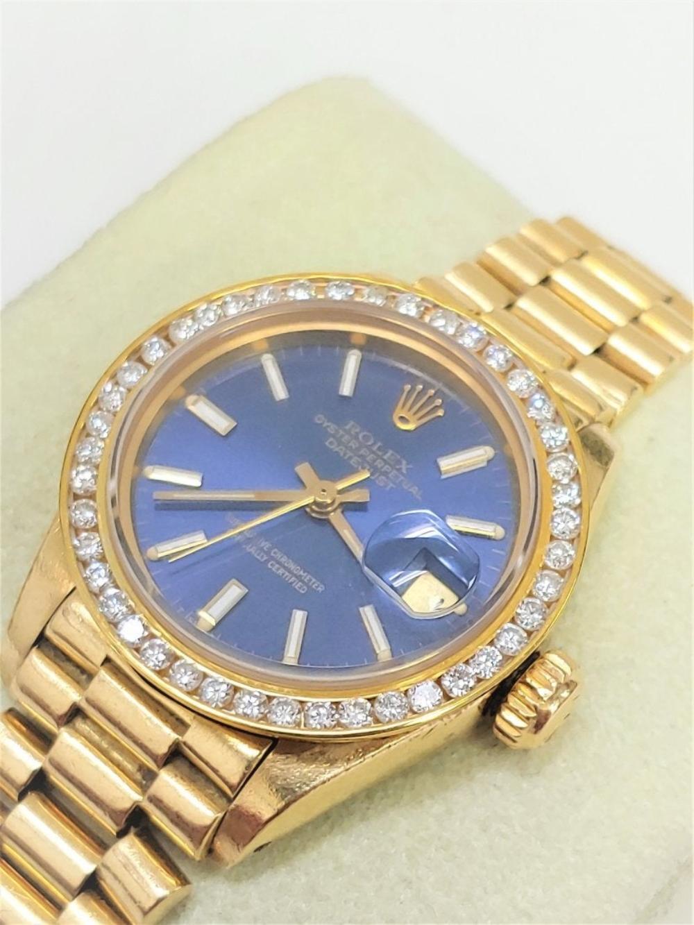 Lot 185: Womens Rolex Presidential Blue Dial 18k Diamonds Watch