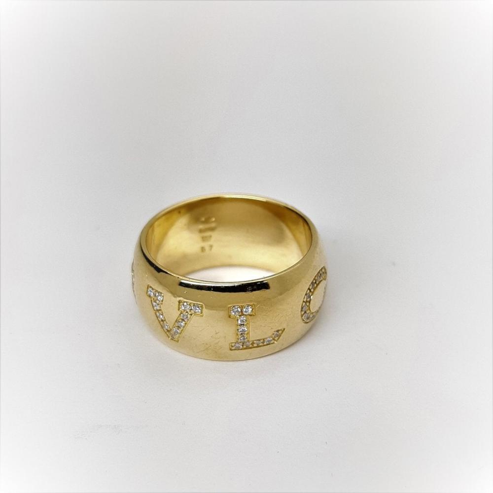 Lot 175: Bulgari 18k Gold Diamond Monologo Wide Band Ring with Box