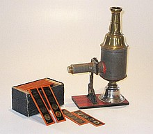 A toy Magic Lantern and slides, 20cm