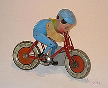 Triang clockwork boy on motorcycle, 21cm