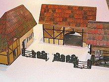 A German painted wooden farm layout and toy farm