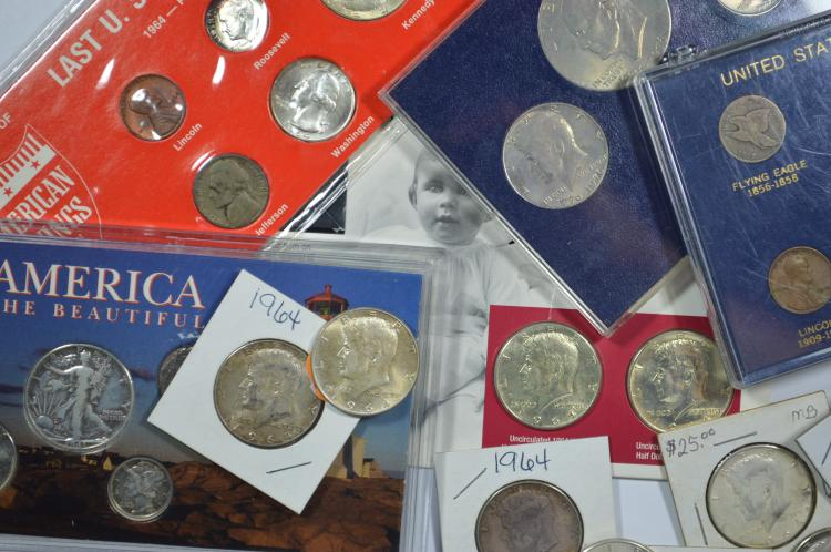 A small lot of U.S. promotional sets plus some additional 90% silver half dollars.