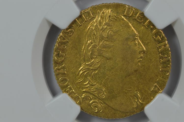 Great Britain 1786 Gold Guinea. NGC AU50, Wings Silver Sticker